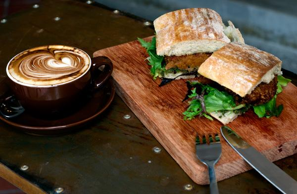 Serving of coffee and delicious sandwich