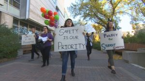 Students parading sexual safety banners