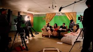 Actors practicing behind the scenes of a film