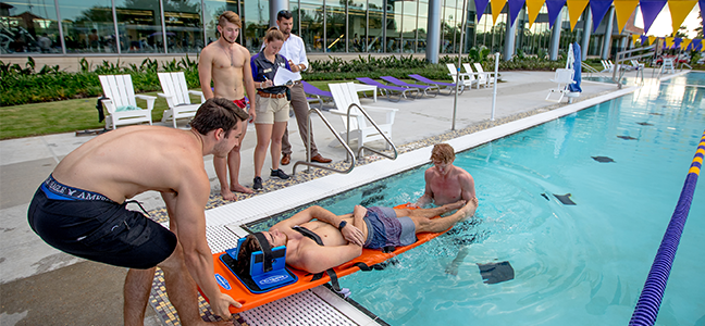 a lifeguard instructor working at swimming pool