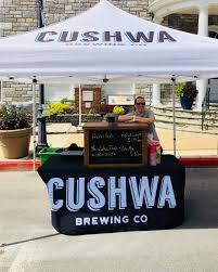 A customer standing under the Cushwa's umbrella