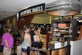 Customers being served at the Einstein Bros. Bagels