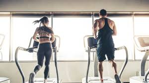 A man and woman in a gym