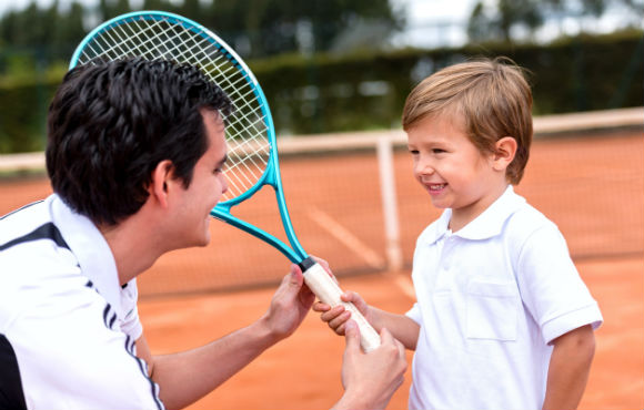 This image shows a student coach working with a child.
