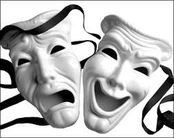 White drama masks. One has a happy face while the other is sad
