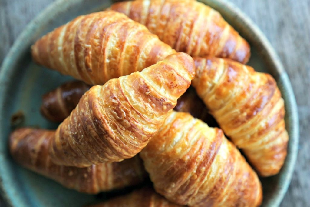Warm croissants served in a dish.