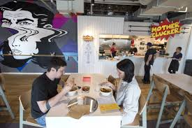 Customers enjoying meals at the KC Food Court