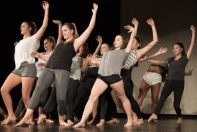 The Dance Team rehearses a contemporary group number for the Dance Showcase.