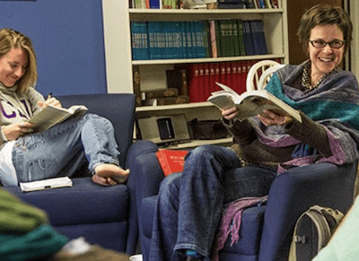 Religion students at Cal Lutheran reading books and laughing