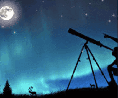 person using telescope looking at the starry skies with a large moon