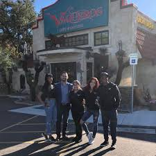 People posing for a photo outside the Los Vaqueros