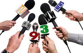 Several microphones being held by hands