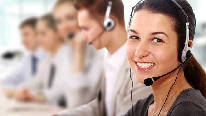 a female Customer Service Representative smiling while looking towards camera
