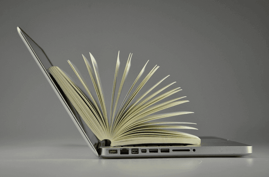 book on top of a laptop