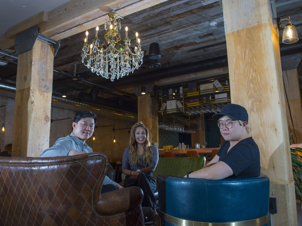 Chef Jake Lee, far right, Issac Choi, and Shangeeta Prasad at DOSC