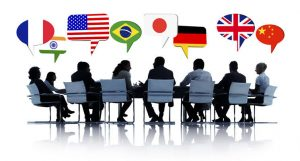 People of diverse nationalities (USA, France, Brazil, Japan, Germany, UK, China, etc) seating in a table making business with each other