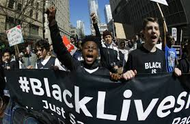 people holding up black lives matter sign a social occurance in america
