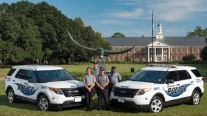 This image shows the UNCW patrol cars and officers.