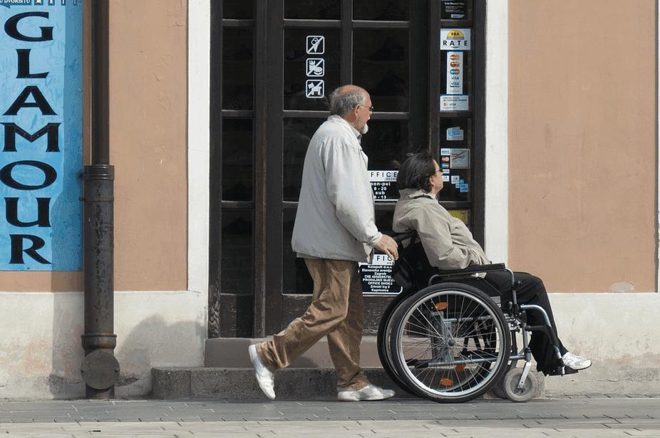 elderly pushing a wheelchair