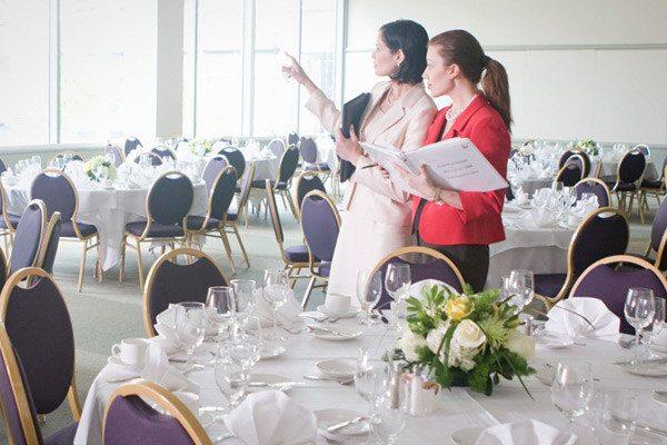 event coordinators checking event arrangements