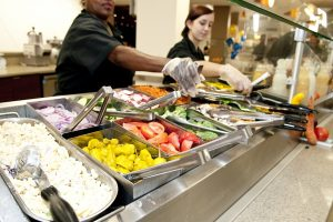 Campus dining team preparing food for students