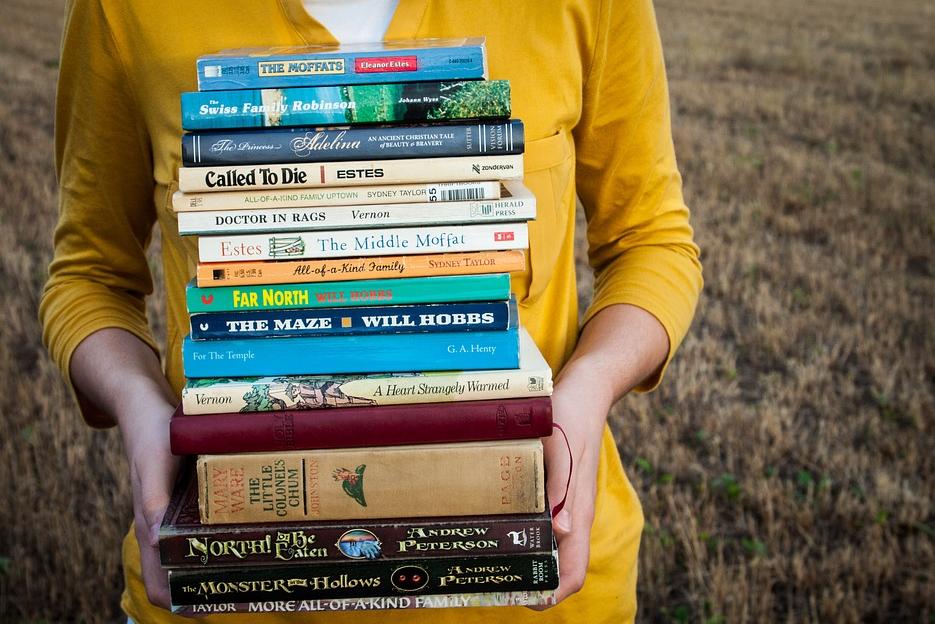 female holding books