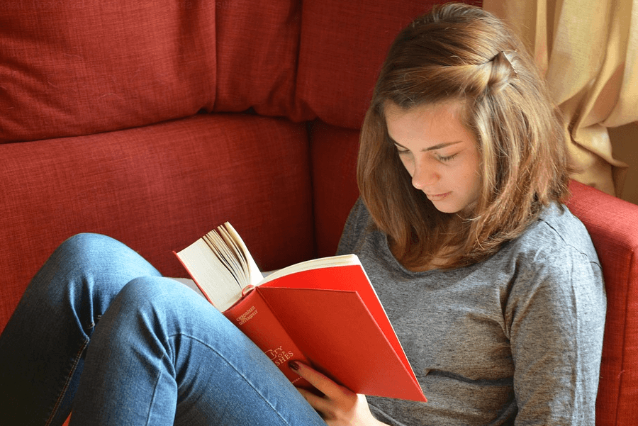 female student reading bible