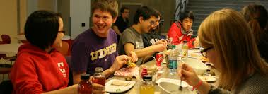 Student gathering eating burgers