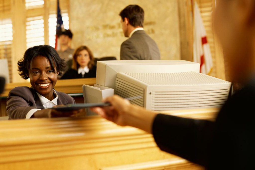A law clerk accepting a file from a guest