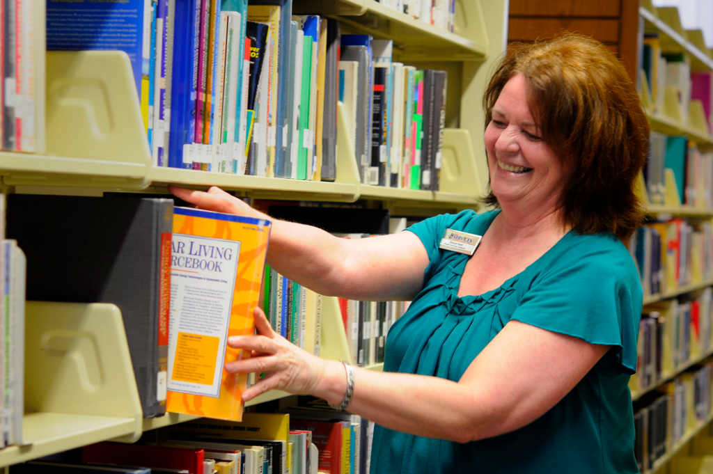 librarian selecting a book