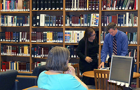 A library assistant helping out a lady