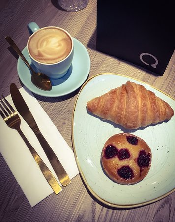 Danishes and small latte in a cup.
