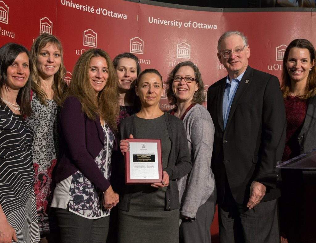A team of University of Ottawa employees receiving the President's Award for Service Excellence