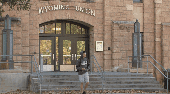 A student standing outside the Wyoming Union building