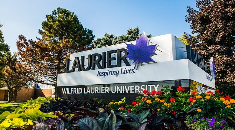 The main sign at the entrance of Wilfrid Laurier University