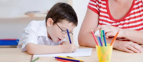 the girl is helping out a child with his homework