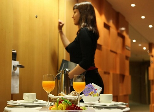 a room service employee serving the orders to clients
