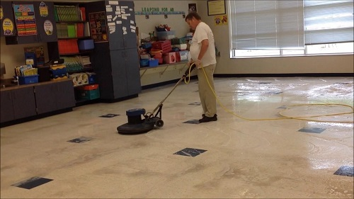 the cleaner is cleaning the floor