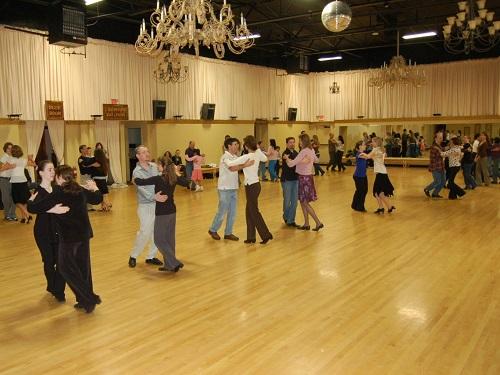 everyone is dancing in the ballroom