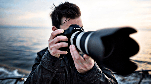 a photographer is taking photos