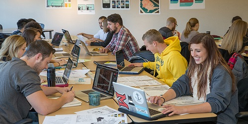 students learning about graphic design through computer