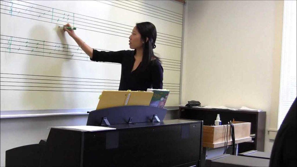 A teacher instructing music skills