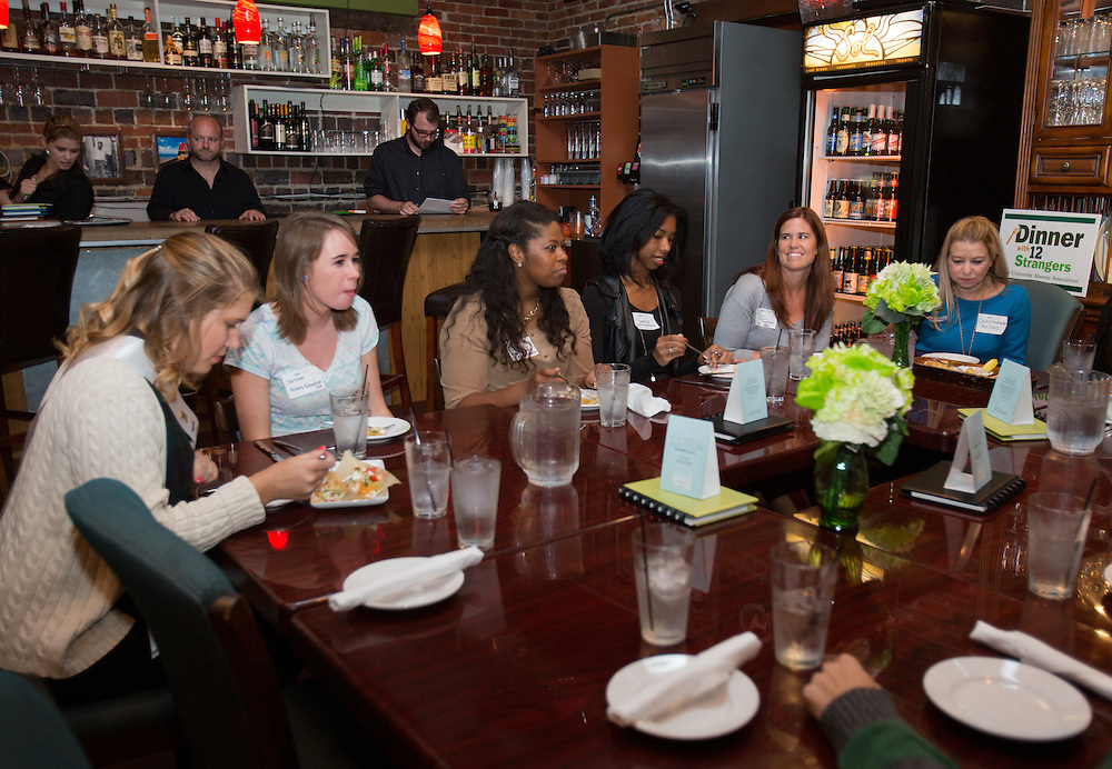 "Ohio University students participate in the Homecoming ""Dinner with 12 Strangers"" event at Sol on Oct. 8, 2014."