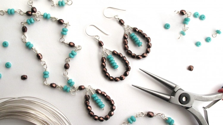 Jewelry making tools and materialsm including a set of earrings and necklace made with beads.