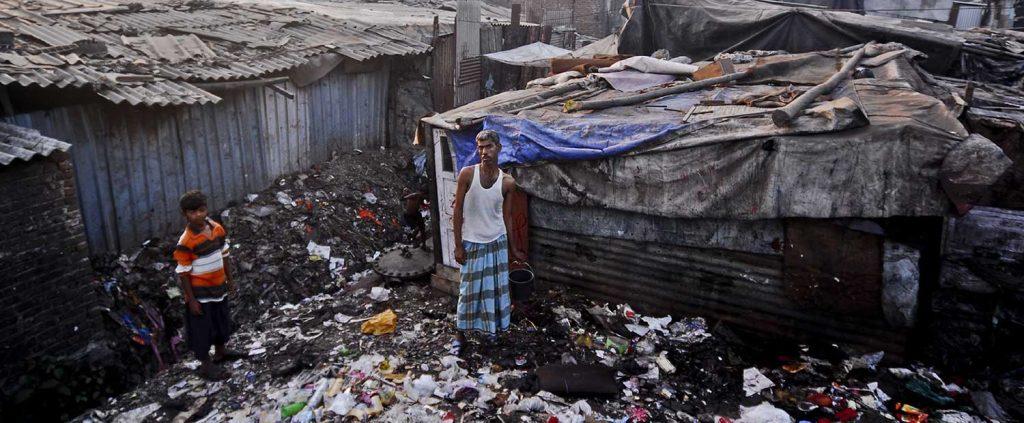 A man and boy standing in slum