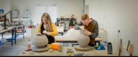 Students working in studio-clay art