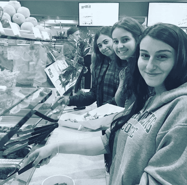 Happy students at the Marymount Manhattan College lining to get food