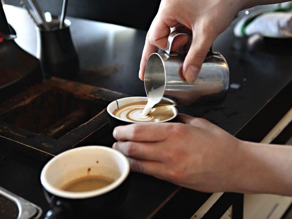 Barista making a latte.