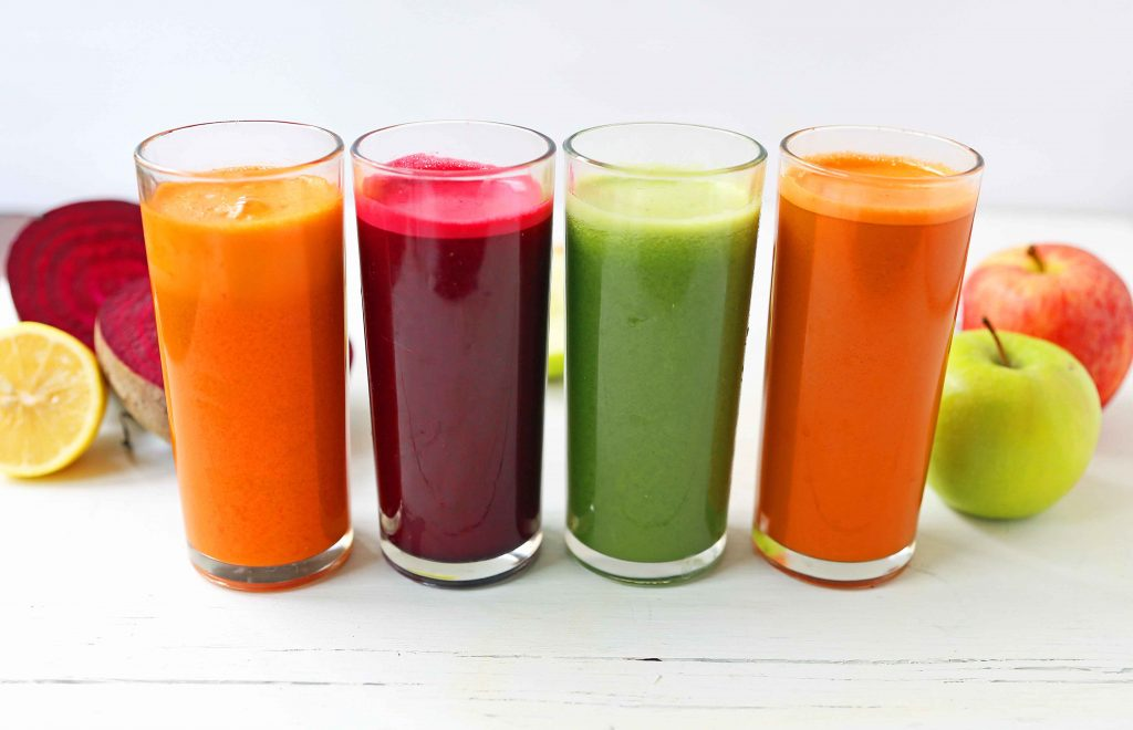 Juices pressed in tall glasses.