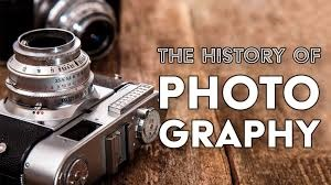 A picture of a digital camera and history of photography inscribed in the picture